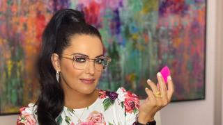 BeautyBlender CEO, Rea Ann Silva holding a beautyblender.